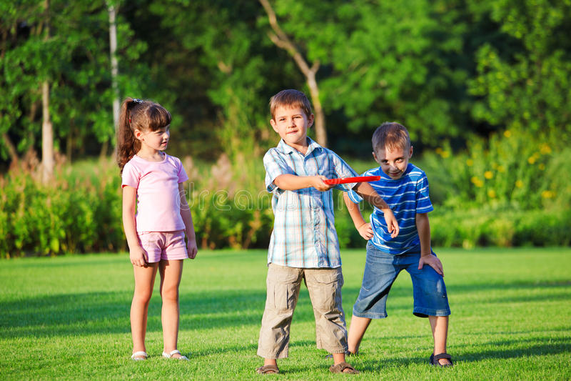 Kids playing freesbee. In the backyard royalty free stock photo