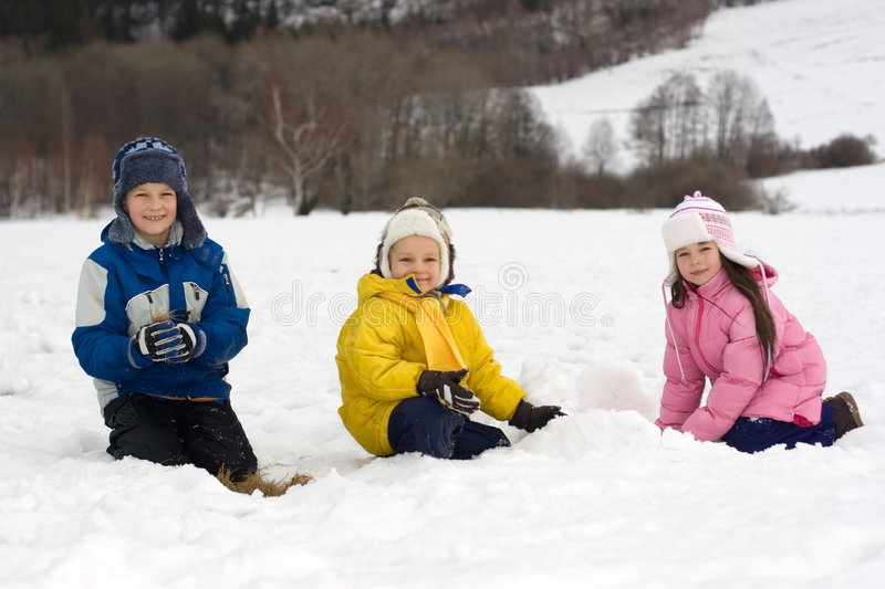 Kids Playing in Fresh Snow stock images
