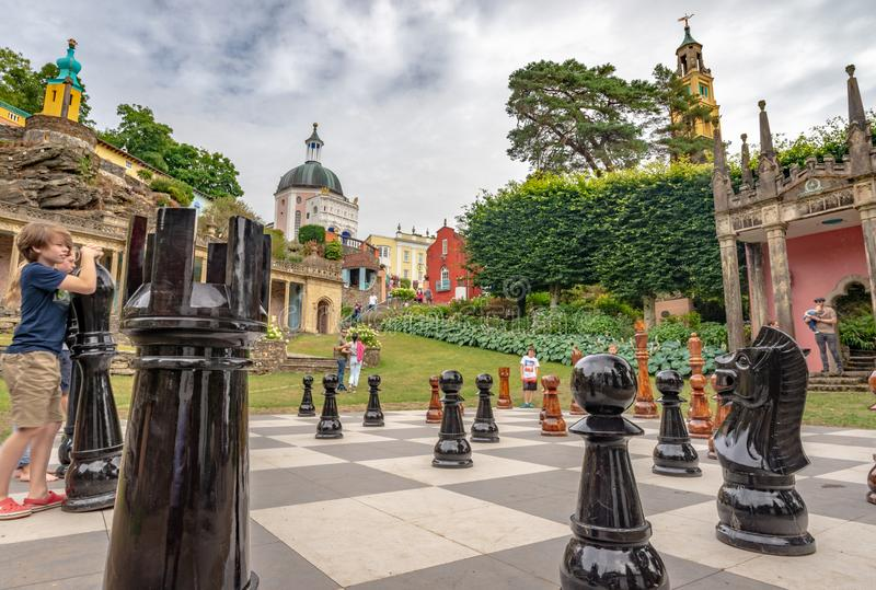 Kids playing with giant chess pieces, Portmeirion, North Wales royalty free stock photos