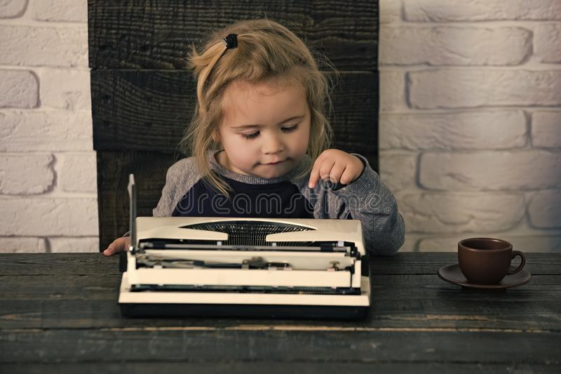 Kids playing - happy game. business kid or small boy or businessman child with typewriter. Kids playing - happy game. business kid or small businessman child stock images
