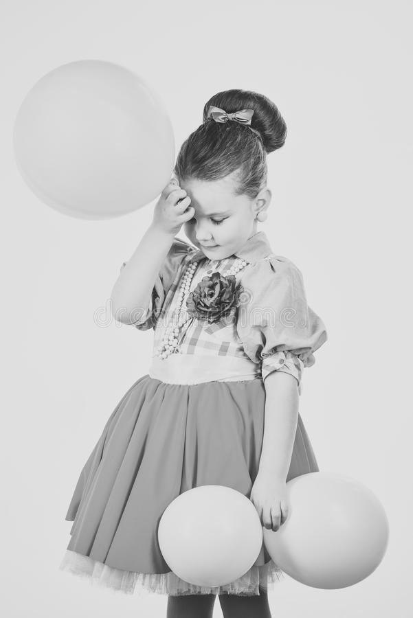 Kids playing - happy game. childhood and happiness. childhood, little girl with pink balloons. stock photo