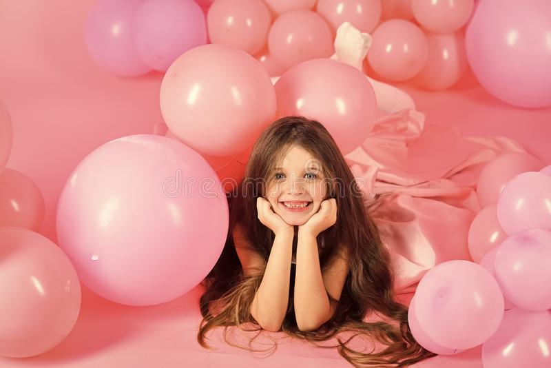 Kids playing - happy game. toddler girl with pink balloon stock photos
