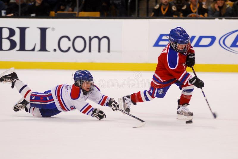 Kids playing hockey at Bruins game royalty free stock image