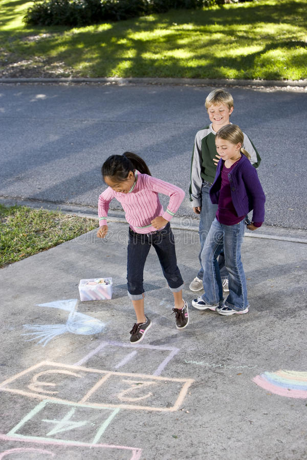 Download Kids playing hopscotch stock photo. Image of multi, multiracial - 16899538