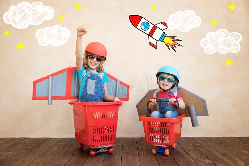 Kids playing with jet pack at home royalty free stock images