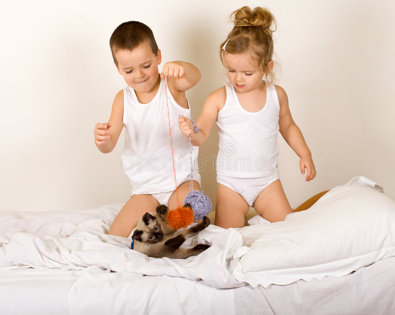Download Kids Playing With A Ktten And Yarn Balls Stock Photo - Image of happy, feline: 8440968