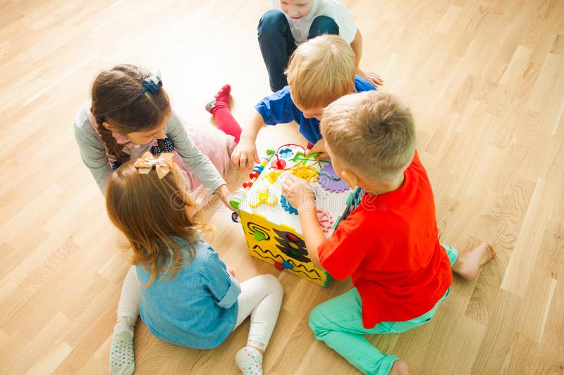Kids playing with large educational toy at home royalty free stock photo