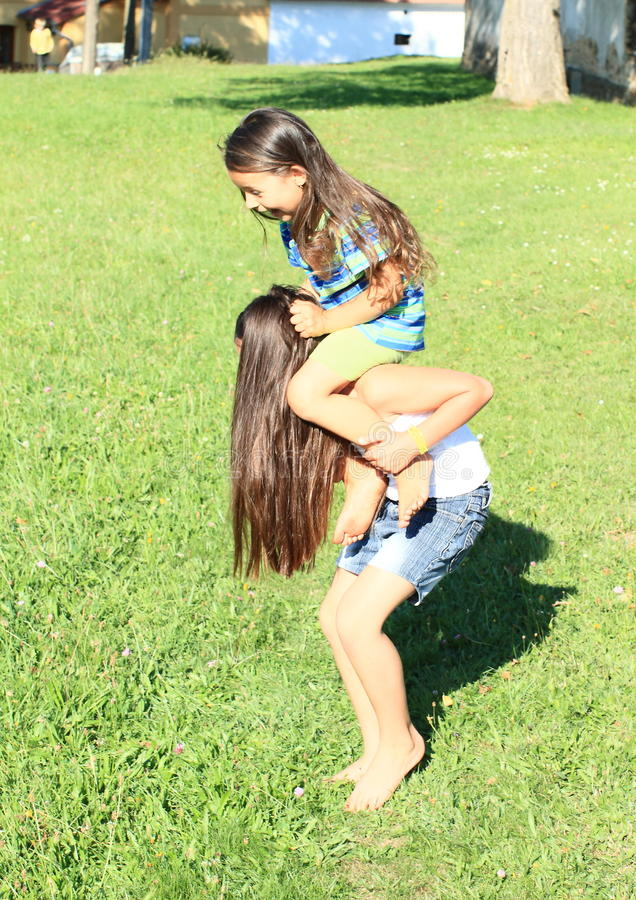 Download Kids playing on meadow stock image. Image of happiness - 33478013