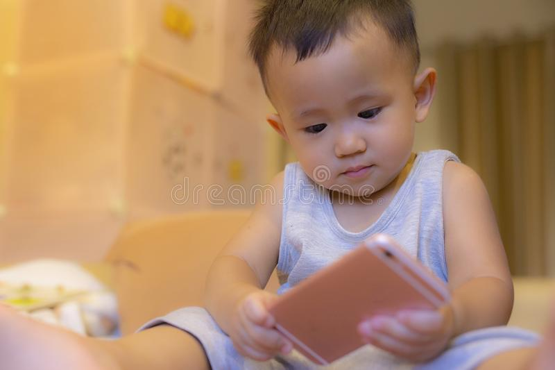 Kids are playing mobile. royalty free stock image
