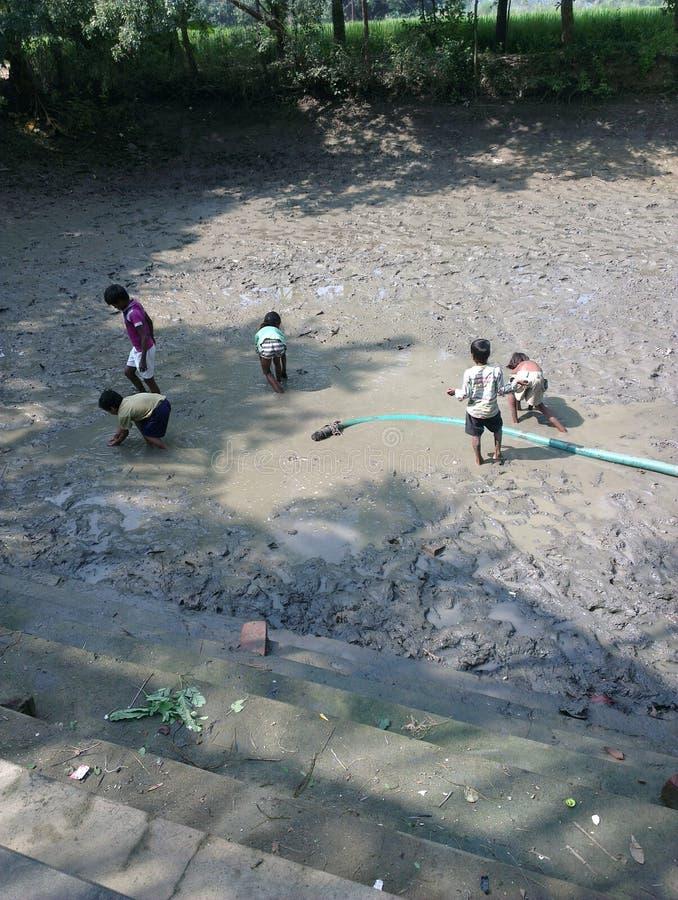 Kids playing in mud stock image