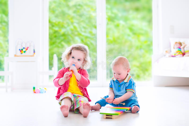 Kids playing music with xylophone royalty free stock images