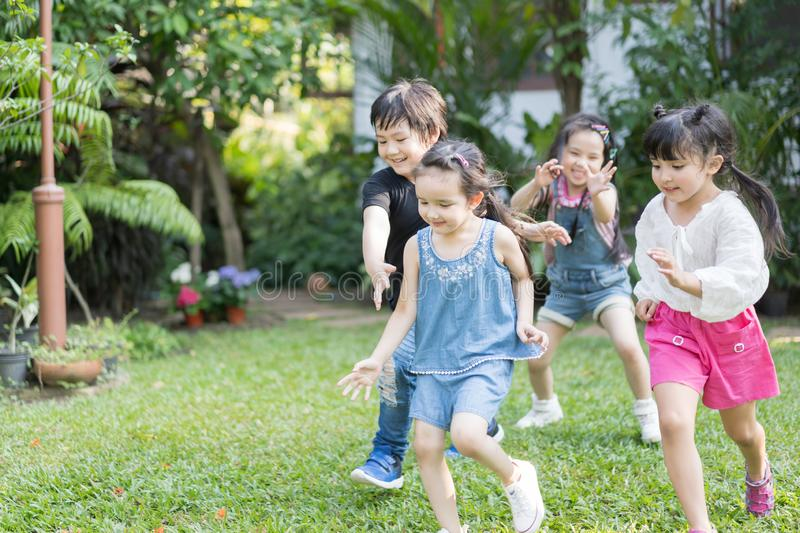 Kids playing outdoors with friends. little children play at nature park. royalty free stock photos