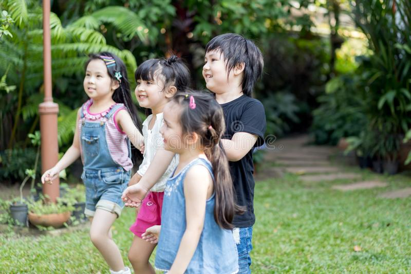 Kids playing outdoors with friends. little children play at nature park. stock images
