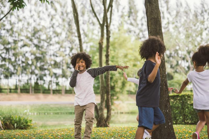 Kids playing outdoors with friends. little children play at nature park. stock photo