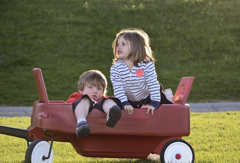 Kids playing outdoors stock photos