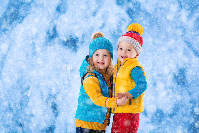 Kids playing outdoors in winter royalty free stock image