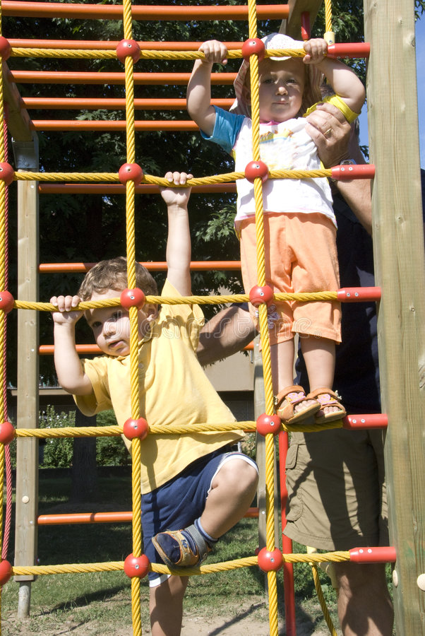 Kids playing in the park stock image
