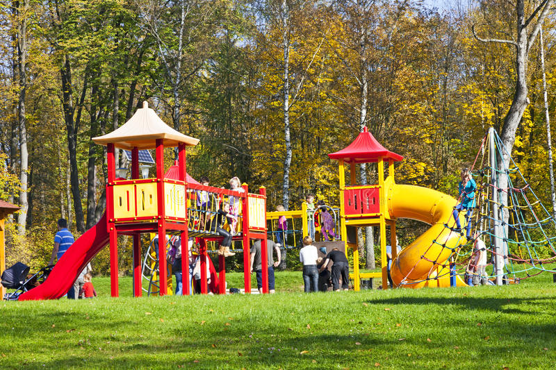 Kids playing in a park playground stock image
