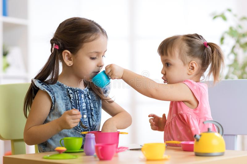 Kids playing with plastic tableware royalty free stock photos