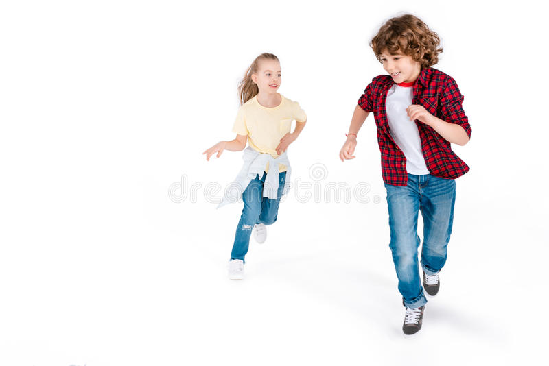 Kids playing in play catch-up. Funny kids playing in play catch-up isolated on white, gaming characters concept royalty free stock photography