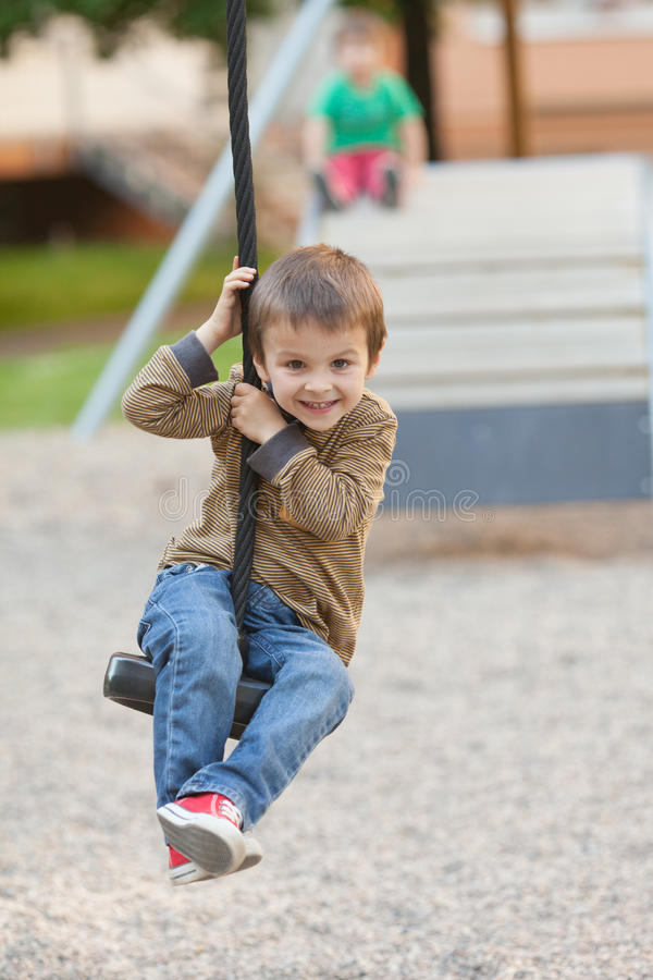 Kids, playing on the playground. Having fun stock images