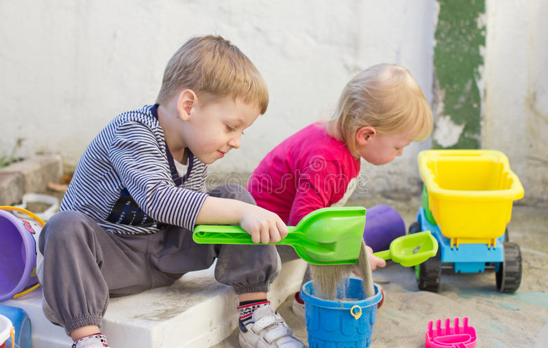Kids playing in playground stock images
