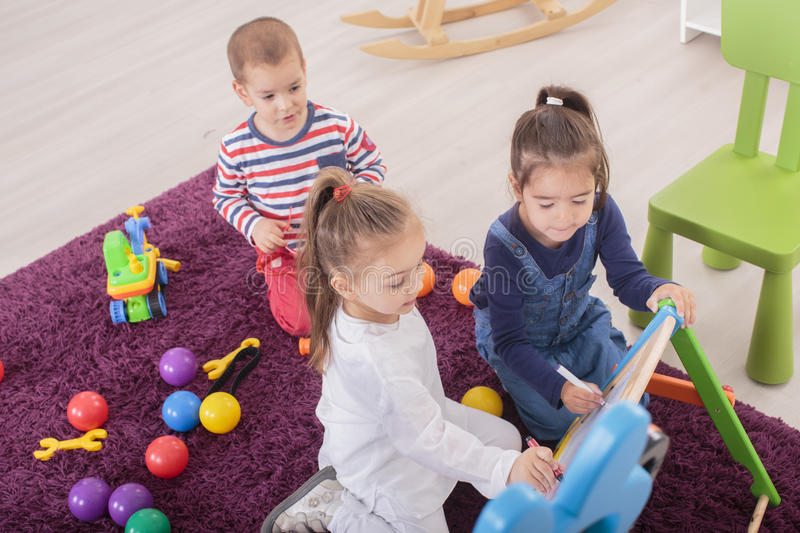Kids playing in room royalty free stock photo