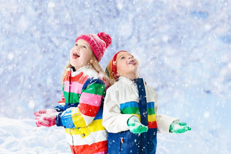 Kids playing in snow. Children play in winter. stock image
