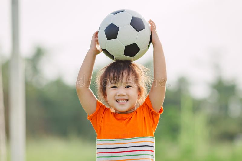 Kids playing soccer football. stock image