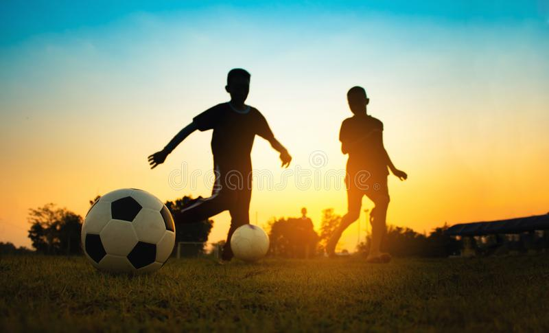 Kids playing soccer football. stock photo