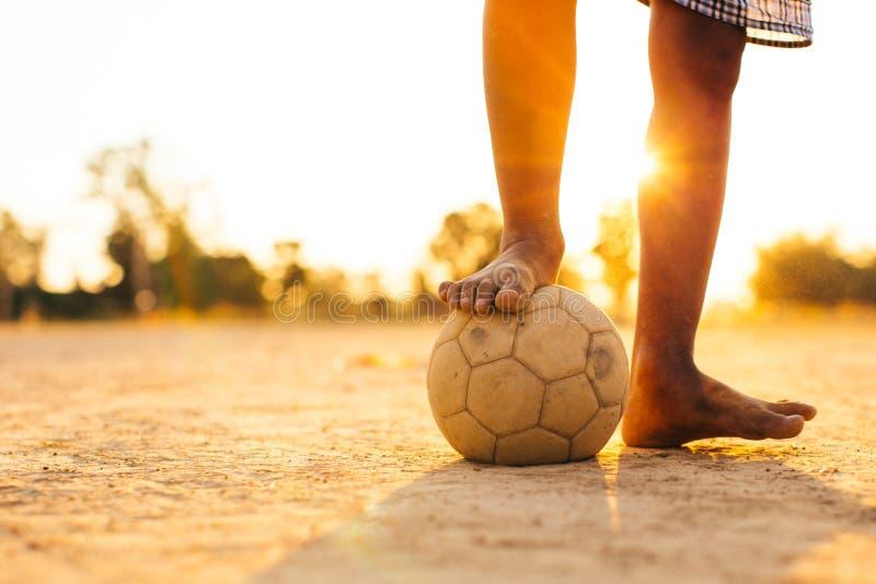 Kids playing soccer football. stock photos