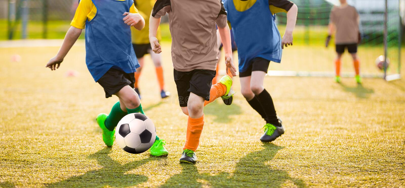 Kids Playing Soccer Game Tournament. Football Soccer Match for Kids royalty free stock photos