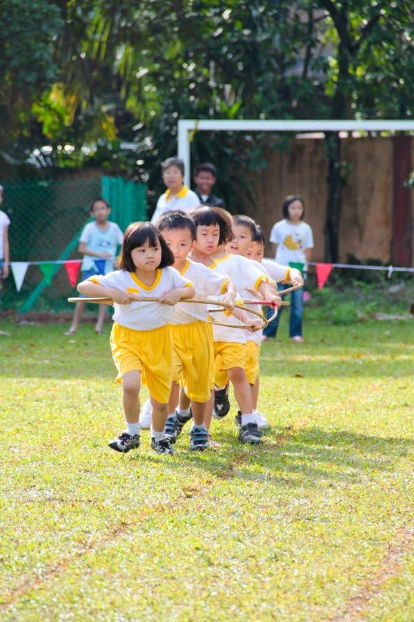 Kids playing teamwork racing royalty free stock image