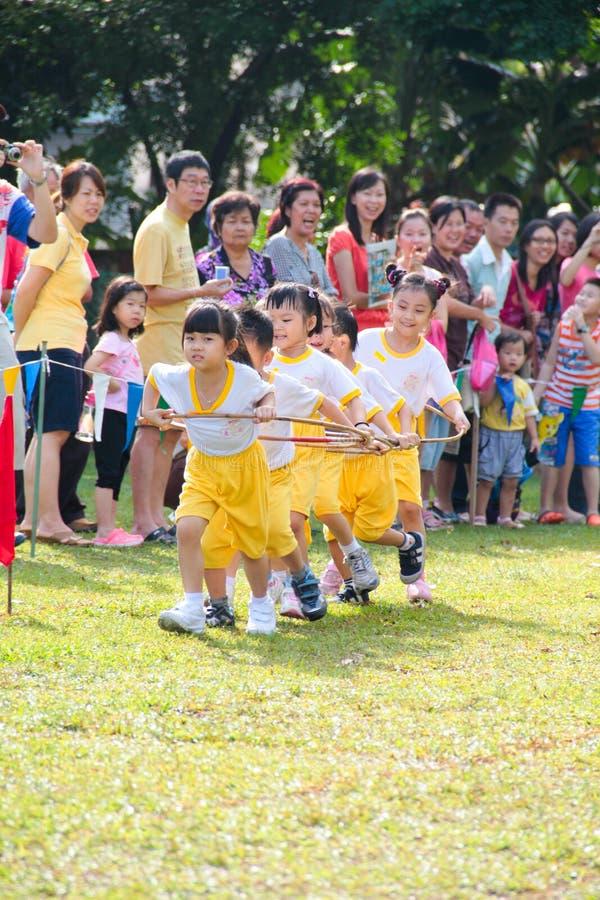 Kids playing teamwork racing stock photo