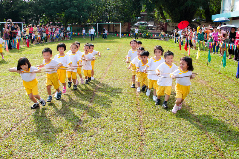 Kids playing teamwork racing stock images