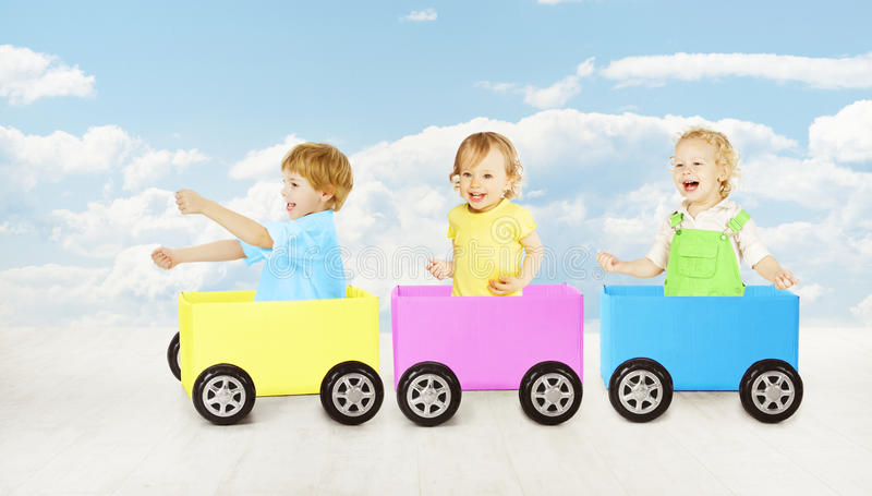 Kids playing toy car. Children passenger sitting in box. Inspiration and creativity cargo concept royalty free stock image