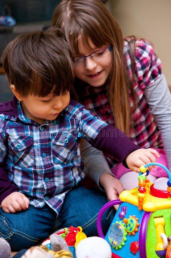Kids playing with toys royalty free stock photos