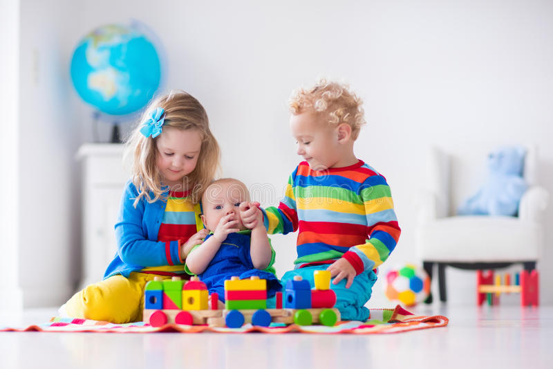 Kids Playing With Wooden Toy Train Stock Image - Image of ...