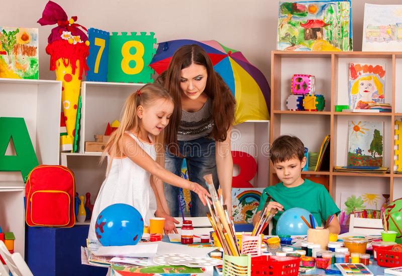 Children painting and drawing together. Craft lesson in primary school. royalty free stock photography