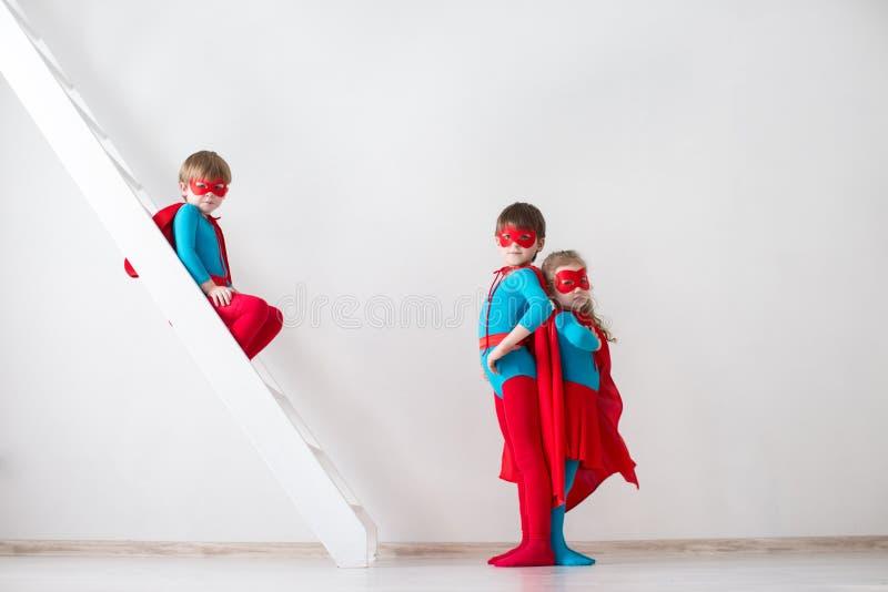 Kids plays superhero. stock photo
