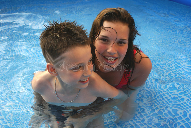 Kids in pool. stock photography