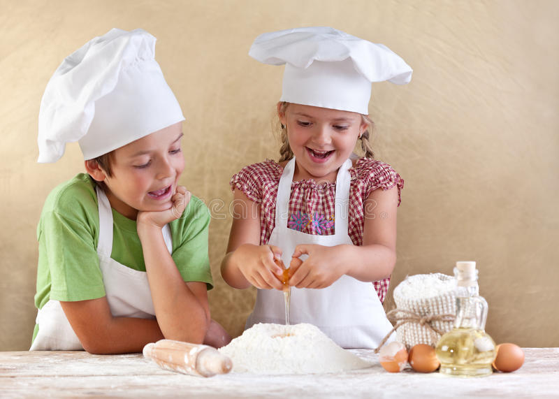 Download Kids Preparing The Dough For A Cookie Stock Image - Image: 25723449