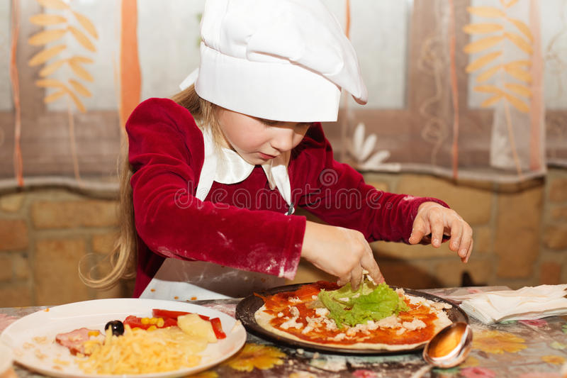 Kids preparing homemade pizza royalty free stock photography