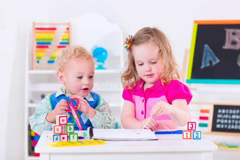 Kids at preschool painting stock photos