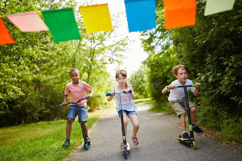 Kids racing in the park stock photo