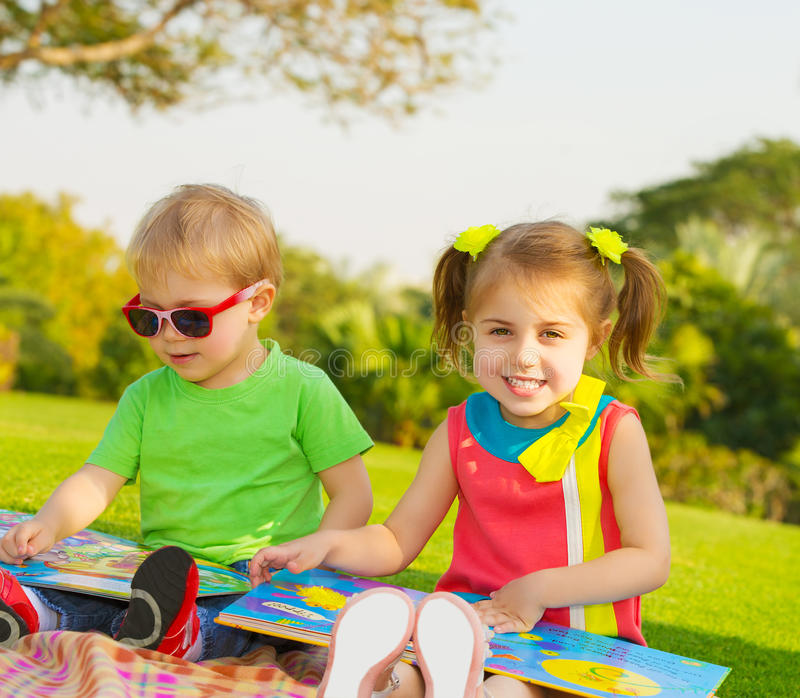 Kids read books royalty free stock photography