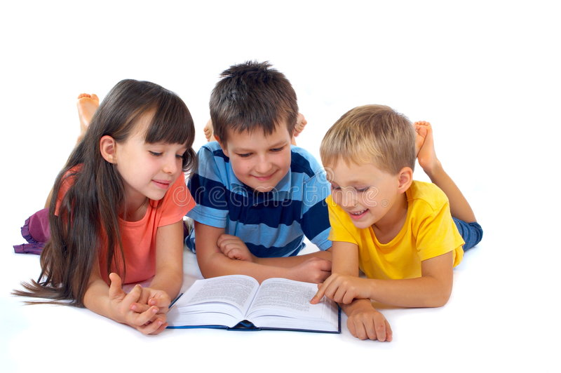 Kids reading book together royalty free stock image