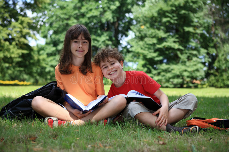 Kids Reading Books Outdoor Royalty Free Stock Photo