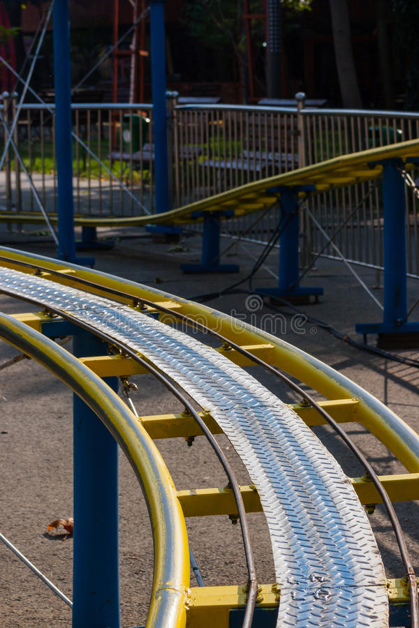 Download Kids Roller Coaster Yellow Rails In Amusement Park. Stock Image - Image: 47595493