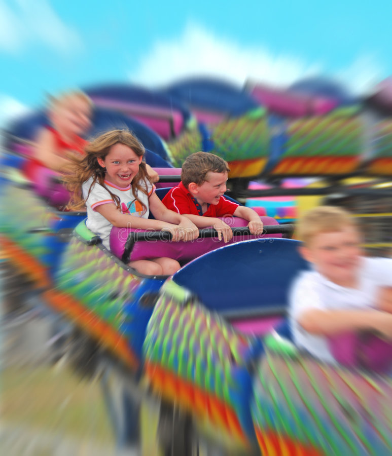Kids on rollercoaster stock images